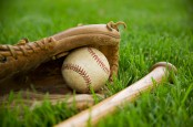 Baseball Equipment Laying on Grass --- Image by © Royalty-Free/Corbis